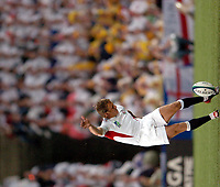 Photo: Richard Lane.<br />Australia v England. Rugby World Cup Final, at the Telstra Stadium, Sydney. RWC 2003. 22/11/2003. <br />Jonny Wilkinson kicks off to start the Rugby World Cup Final.