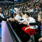 Anadolu Efes's coach Ufuk Sarica (L) during their Turkish Airlines Euroleague Basketball Group C Game 8 match Anadolu Efes between EA7 Emporio Armani Milan at Sinan Erdem Arena in Istanbul, Turkey, Wednesday, December 07, 2011. Photo by TURKPIX