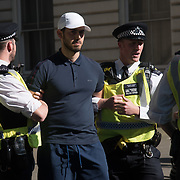 Police arrested a protestor during the protests against the Turkey President visiting Downing street invited by Therese May chanting Erdogan is a terrorist with heavy police of guards on 15 May 2018, London, UK.