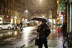 © Licensed to London News Pictures. 12/01/2017. London, UK. People commute in Camden, north London whilst the first snow of the season starts to fall in London on Thursday, 12 January 2017. Photo credit: Tolga Akmen/LNP