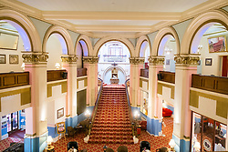 Main Staircase and lounge in the Grand Hotel A Grade II listed building Dominating Scarborough South Bay. When completed in 1867 it was one of the largest hotels in the world, as well as one of the first giant purpose-built hotels in Europe. The hotel is in the shape of a 'V' in honour of Queen Victoria and was designed around the theme of time: <br /> 4 towers to represent the seasons, <br /> 12 floors for the months of the year, <br /> 52 chimneys symbolise the weeks, <br /> originally there were 365 bedrooms - one for each day of the year. <br /> As Scarborough was a famous 'Spa Town' in its heyday the Grand hotels baths included an extra pair of taps so guests could wash in seawater as well as fresh water.<br /> The hotel was badly damaged when the German Navy bombarded the town in 1914.<br /> Three blue plaques outside mark where the novelist Anne Brontë died in 1849, the contribution of the RAF trainees stationed at the hotel during the Second World War, and the original opening of the building.<br />  12 September 2015<br />  Copyright Paul David Drabble<br />  www.pauldaviddrabble.photoshelter.comom