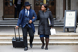 © Licensed to London News Pictures. 23/02/2018. London, UK. Lanre Haastrup (L) and Takesha Thomas (R), parents of 11-month-old Isaiah Haastrup, leave the High Court in London after judges ruled that doctors at King's College Hospital can withdraw life support for their son who has suffered severe brain damage. Photo credit: Rob Pinney/LNP