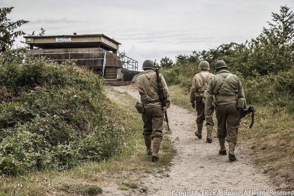 USA, Oregon, Astoria, Ft. Stevens State Park, living historian infantry soldiers in walking to command bunker.
