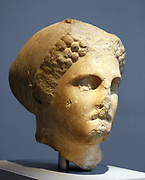 Head from a colossal statue of a woman wearing a sakko (cap) Parian marble found to the north west of the Mausoleum, about 350 BC The head comes from a statue of similar size to the colossal female figure displayed in this room (the-so-called Artemisia, Sculpture (100). This portrait may represent one of the female members of the Hekatomnid dynasty. The series of Dynastic portraits probably stood between the Ionic columns of the peristyle.