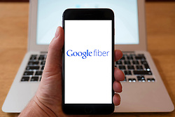 Using iPhone smartphone to display logo of Google filer high speed internet and TV service