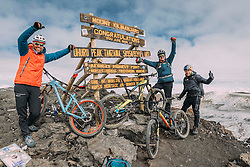 Swiss-American Hans Rey, German Gerhard Czerner and Scotthis Danny MacAskill reach Uhuru Peak on 5895m / 19341 ft with their mountain bikes after a 7 hour climb, carrying their bikes up.
