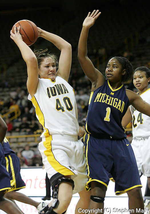 08 February 2007: Iowa center Stacy Schlapkohl (40) tries to keep the ball away from Michigan forward LeQuisha Whitfield (1) in Iowa's 66-49 win over Michigan at Carver-Hawkeye Arena in Iowa City, Iowa on February 8, 2007.