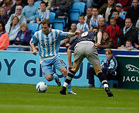 Photo: Leigh Quinnell.<br /> Coventry v Reading. Coca Cola Championship.<br /> 10/09/2005. Coventrys Gary McSheffrey pushes readings Bryjar Gunnarson out of the way.