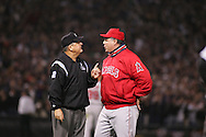 CHICAGO - OCTOBER 12:   Angeles Manager Mike Scioscia argues the call made by Doud Eddings after AJ Pierzynski of the Chicago White Sox struck out but advanced to first base after home plate umpire Doug Eddings ruled that Josh Paul trapped the ball and failed to tag Pierzynski in the 9th inning during Game 2 of the American League Championship Series against the Los Angeles Angels of Anahiem at U.S. Cellular Field on October 12, 2005 in Chicago, Illinois.   The White Sox defeated the Angels 2-1.