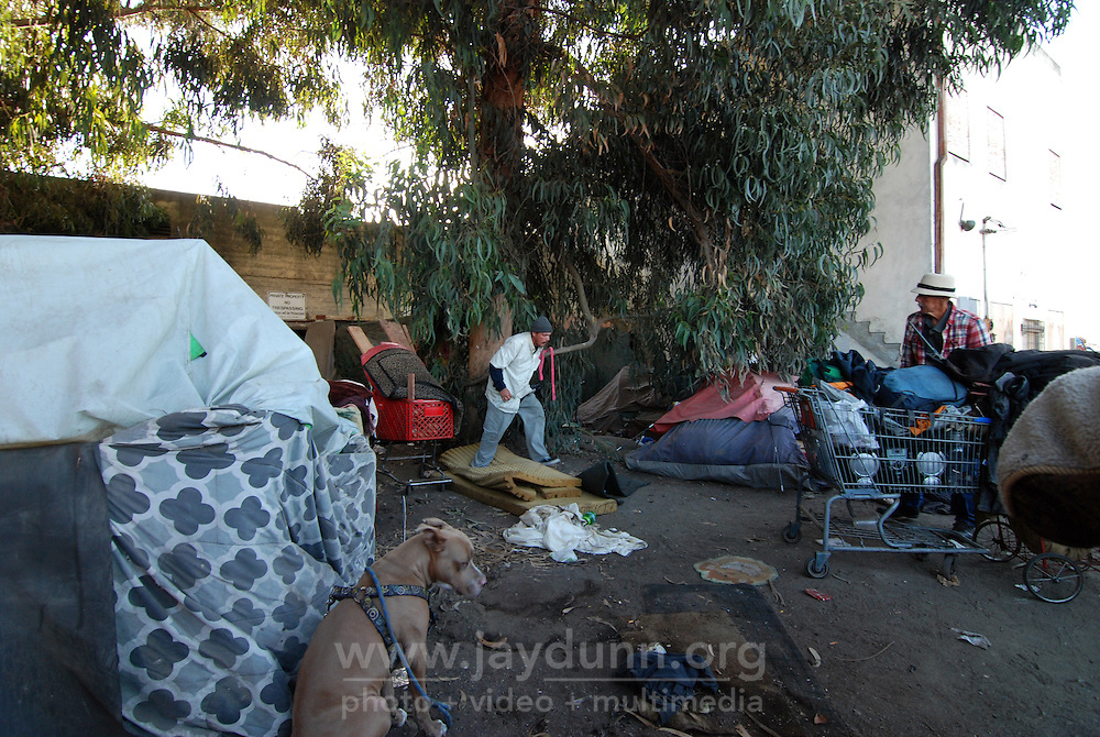 Residents of 38 Soledad St. hurry to break down their tents on Monday.