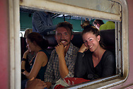 Two travelers from Denmark sit on a train about to depart Nuwara Eliya for the scenic, several-hour journey to Ella, Sri Lanka.