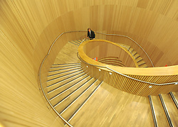 © Licensed to London News Pictures. 21/11/2011, London, UK. The central wooden staircase in the library. London's Southwark Council previews Canada Water Library its new 'super library', featuring a 150-seat theatre, restaurant and cafe, evening class space community meeting rooms and Tube station entrance and exit. The building opens to the public on November 28. Photo credit : Stephen Simpson/LNP