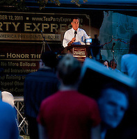 Mitt Romney addresses the crowd gathered at Rollins Park in Concord for the Tea Party Express Tour Sunday evening.  (Karen Bobotas/for the Concord Monitor)