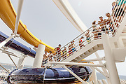 Royal Caribbean, Harmony of the Seas, spiraling five decks above the landscaped, open-air Central Park in the center of the ship, waterslides Cyclone, Typhoon and Supercell come together as The Perfect Storm. Guests can challenge each other and race to the finish line with Cyclone and Typhoon, which twist and turn down three decks, while sliders in Supercell will be swirled around its unique champagne bowl before descending into a big splash finale.