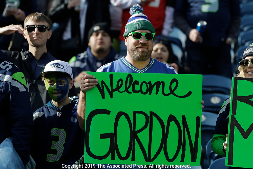 A fan holds a sign welcoming Seattle Seahawks wide receiver Josh Gordon to the team before an NFL football game against the Tampa Bay Buccaneers, Sunday, Nov. 3, 2019, in Seattle. (AP Photo/John Froschauer)