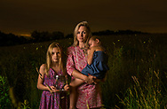 Ana Polish of Sauquoit, New York and her daughters Josephine, 10, and Katherine Polish, 6, after an evening of hunting for lightning bugs.