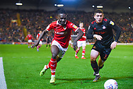Jordan Green of Barnsley (15) and Lynden Gooch of Sunderland (11) chase the ball during the EFL Sky Bet League 1 match between Barnsley and Sunderland at Oakwell, Barnsley, England on 12 March 2019.