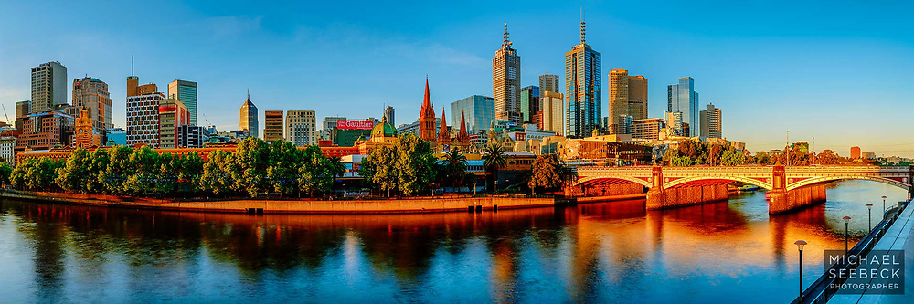 A panoramic photograph of Melbourne and the Yarra River bathed in warm late afternoon sunlight, just before sunset.<br /> <br /> Limited Edition of 125
