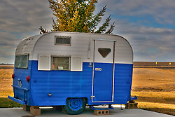 08 February 2012:  1953 Travel Trailer (camper) on display at the renovated and historic Standard Oil Station along Route 66 in Odell Illinois...This image is a High Dynamic Range illustration utilizing a stack of three images.