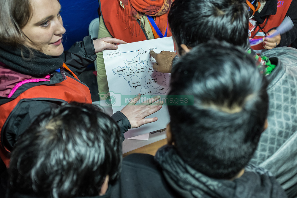 October 25, 2016 - Calais, France - Migrants show on the map at the registration center near the Calais Jungle on the map where they want to be distributed  in Calais, France, on 25 October 2016. Up to the evening, about 4,000 migrants from the Refugee camp on the coast at the English Channel were distributed to several regions in France. (Credit Image: © Markus Heine/NurPhoto via ZUMA Press)