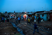 KENYA. Nairobi. Railway passing through the slum in Kibera. Often used as the main walkpath through the slum...Kibera is Africa's largest slum and it is located in Nairobi, Kenya. It houses one million people squeezed into less than a square mile.