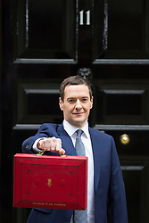 © Licensed to London News Pictures. 08/07/2015. London, UK. British Chancellor of the Exchequer, GEORGE OSBORNE poses on the step of Number 11 Downing Street holding the Red box containing the first fully Conservative budget in 19 years.  Photo credit: Ben Cawthra/LNP