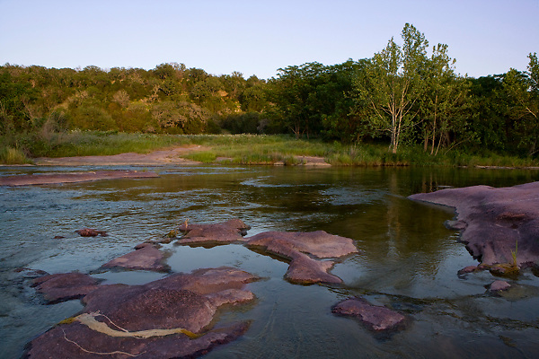 Stock photo of the pink granite rocks along the Llano River in the Texas Hill Country