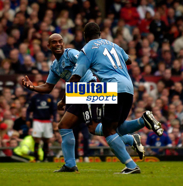 Photo: Jed Wee.<br /> Manchester Utd v Manchester City. The Barclays Premiership. 10/09/2005.<br /> <br /> Manchester City's Trevor Sinclair (L) celebrates with goalscorer Darius Vassell.