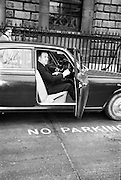 Neill Blaney, Minister for Local Government, takes the wheel to complete the new driving test. It was probably not a good idea to begin in a NO PARKING zone ..23.03.1964