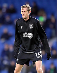 Burnley's Peter Crouch warms up ahead of the Premier League match at the AMEX Stadium, Brighton.