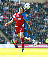 Photo: Chris Ratcliffe.<br />Leyton Orient v Grimsby Town. Coca Cola League 2. 17/04/2006.<br />Craig Easton (L) of Leyton Orient goes up for a header with Jean-Paul Kalala of Grimsby