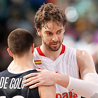15 July 2012: Nando De Colo of Team France is congratulated by Pau Gasol during a pre-Olympic exhibition game won 75-70 by Spain over France, at the Palais Omnisports de Paris Bercy, in Paris, France.