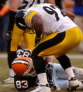Pittsburgh linebacker James Harrison taunts tight end Aaron Shea on the last play of the game yesterday.