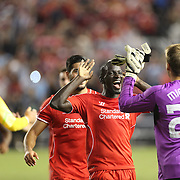 Mamadou Sakho, Liverpool, congratulates goalkeeper Simon Mignolet after Liverpool won a penalty shoot out during the Manchester City Vs Liverpool FC Guinness International Champions Cup match at Yankee Stadium, The Bronx, New York, USA. 30th July 2014. Photo Tim Clayton