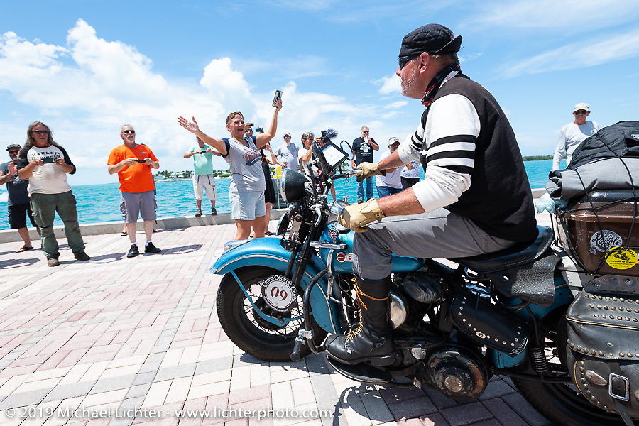 Chris Tribbey riding his 1947 Harley-Davidson WL Flathead across the finish line of the Cross Country Chase motorcycle endurance run from Sault Sainte Marie, MI to Key West, FL. (for vintage bikes from 1930-1948). The Grand Finish in Key West's Mallory Square after the 110 mile Stage-10 ride from Miami to Key West, FL and after covering 2,368 miles of the Cross Country Chase. Sunday, September 15, 2019. Photography ©2019 Michael Lichter.