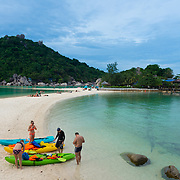 People with kayaks on Nang Yuan island beach, Ko Tao island, Thailand