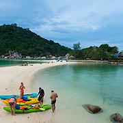 People with kayaks on Nang Yuan island beach, Ko Tao island, Thailand