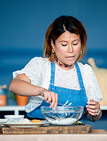 Ping Coombes cooking  at the Big Feastival 2021 on Alex James' Cotswolds farm, Kingham  oxfordshire