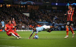 Manchester City's Raheem Sterling (centre) goes down in penalty area under pressure from Shakhtar Donetsk's Mykola Matviyenko (right) which results in a penalty kick