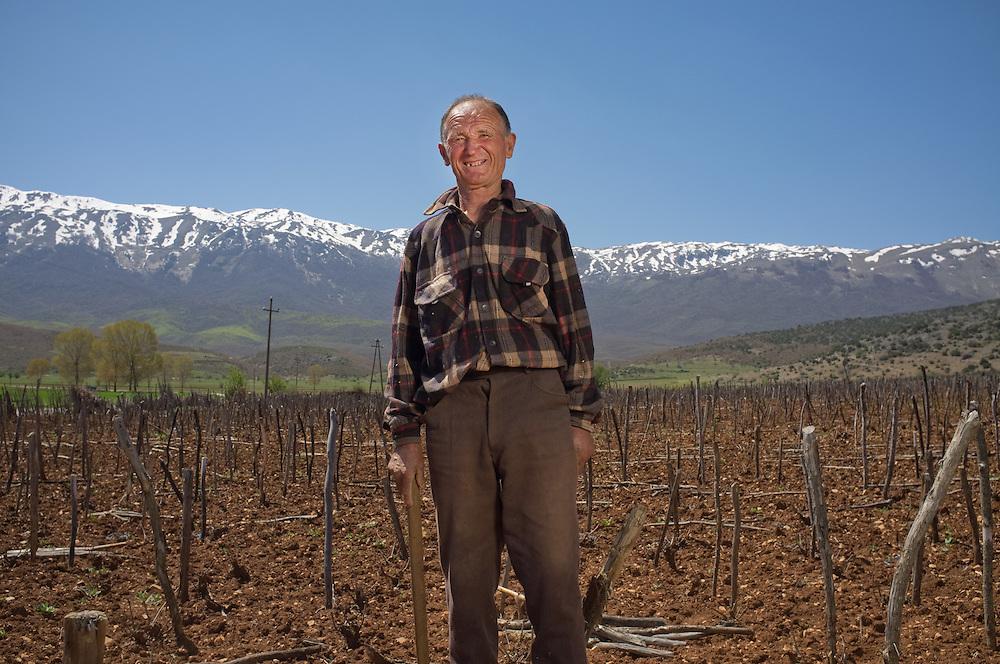 Kico Kitan (70) in his field near the village of Tuminec, Albania