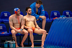 Pascal Janssen, Jorn Muller of the Netherlands disappointed against Montenegro during the Olympic qualifying tournament. The Dutch water polo players are on the hunt for a starting ticket for the Olympic Games on February 19, 2021 in Rotterdam
