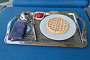 Waffles on a room service tray in a luxury hotel