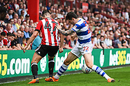 Brentford Forward Sergi Canos (47) Queens Park Rangers Midfielder Pawel Wszolek (22) battle for the ball during the EFL Sky Bet Championship match between Brentford and Queens Park Rangers at Griffin Park, London, England on 21 April 2018. Picture by Stephen Wright.