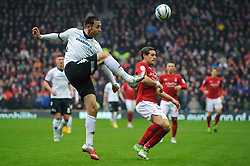 Derby Defender Richard Keogh (IRL) clears during the first half of the match - Photo mandatory by-line: Rogan Thomson/JMP - Tel: Mobile: 07966 386802 19/01/2013 - SPORT - FOOTBALL - Pride Park - Derby. Derby County v Nottingham Forest - npower Championship. The meeting of these two local sides is known as the East Midlands Derby with the winner claiming the Brian Clough Trophy.