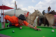 Khui Doloon Khudag, Mongolia, July 2003..Competitors & spectators at the horse racing in the national Naadam 40 kilometres outside Ulaanbaatar..Pool players at a nomad ger camp near the race-track.