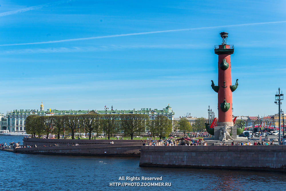 Rostral Column On Vasilievksy Island and Winter Palace behind, St. Petersburg