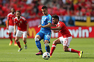 Robert Mak of Slovakia © gets to the ball ahead of Neil Taylor of Wales (r). Euro 2016, Wales v Slovakia at Matmut Atlantique , Nouveau Stade de Bordeaux  in Bordeaux, France on Saturday 11th June 2016, pic by  Andrew Orchard, Andrew Orchard sports photography.