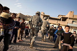 Members of the 1st Infantry, 17th Regiment, help Iraqi forces on patrol western Mosul, Iraq, Dec. 14, 2005. This is part of an effort to provide security in preparation for Iraq's first post-Saddam parliamentary elections. The western sector is home to Mosul's primarily Sunni population, which has been resistant to the American presence in Iraq.