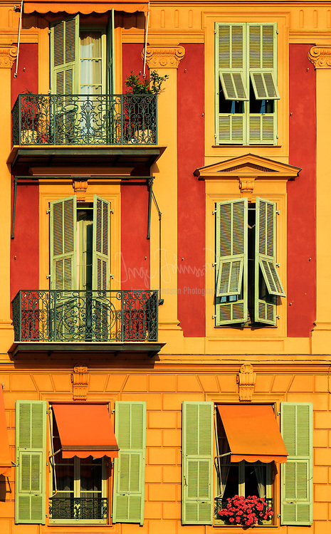 Typical French windows on residential building near the port in Nice, France