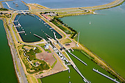 Nederland, Friesland, Kornwerderzand, 05-08-2014; Afsluitdijk met sluizencomplex, Waddenzee aan de horizon.<br /> Enclosure Dam near the Frisian coast. Sluices and locks. Left Waddenzee, IJsselmeer right.<br /> luchtfoto (toeslag op standaard tarieven);<br /> aerial photo (additional fee required);<br /> copyright foto/photo Siebe Swart.